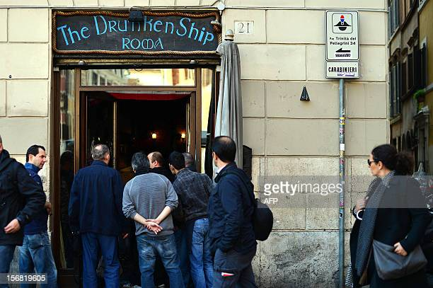 People look inside the Drunken Ship pub at Campo di Fiori after a fight overnight between Lazio and Tottenham supporters on the eve of the Europa...
