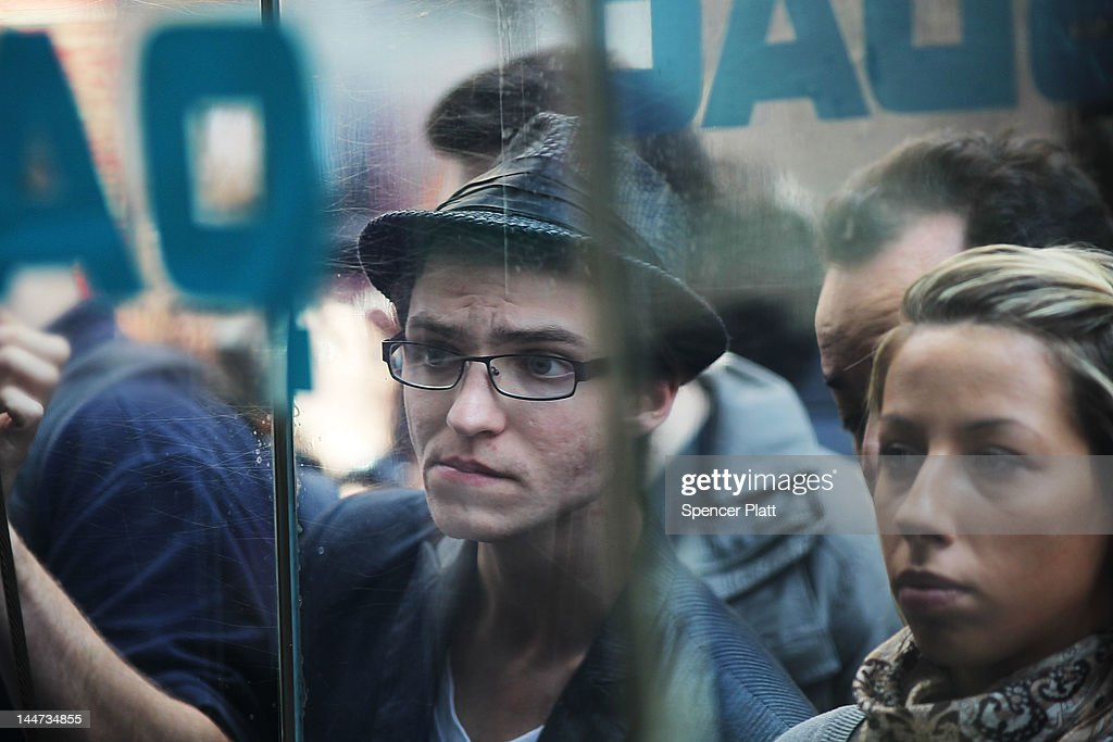 People look into the window of the Nasdaq stock market moments before Facebook shares went public on May 18, 2012 in New York, United States. The social network site began trading after 11:30 a.m. with shares jumping 13% to $43 before quickly falling. On Thursday Facebook priced 421 million shares at $38 each. Facebook, a Menlo Park, California based company, will have a valuation exceeding $100 billion.