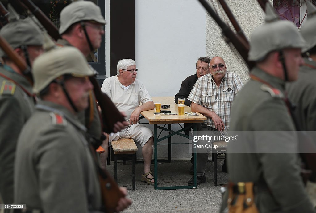 People look on as history reenactors dressed as World War I German soldiers parade past on May 27, 2016 in Verdun, France. The governments of France and Germany will commemorate the 100th anniversary of the World War I Battle of Verdun with ceremonies this coming Sunday. Approximately 300,000 soldiers lost their lives in the 10-month campaign that was among the most grueling battles of World War I.