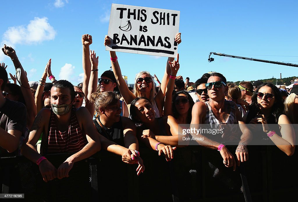 People look on as Pharrell Williams performs live for fans as part of the 2014 Future Music Festival at Royal Randwick Racecourse on March 8, 2014 in Sydney, Australia.