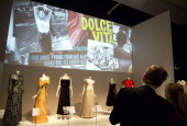 People look on at a display during the press review of The Glamour of Italian Fashion 19452014 exhibition at the VA Museum in London on April 2 2014...