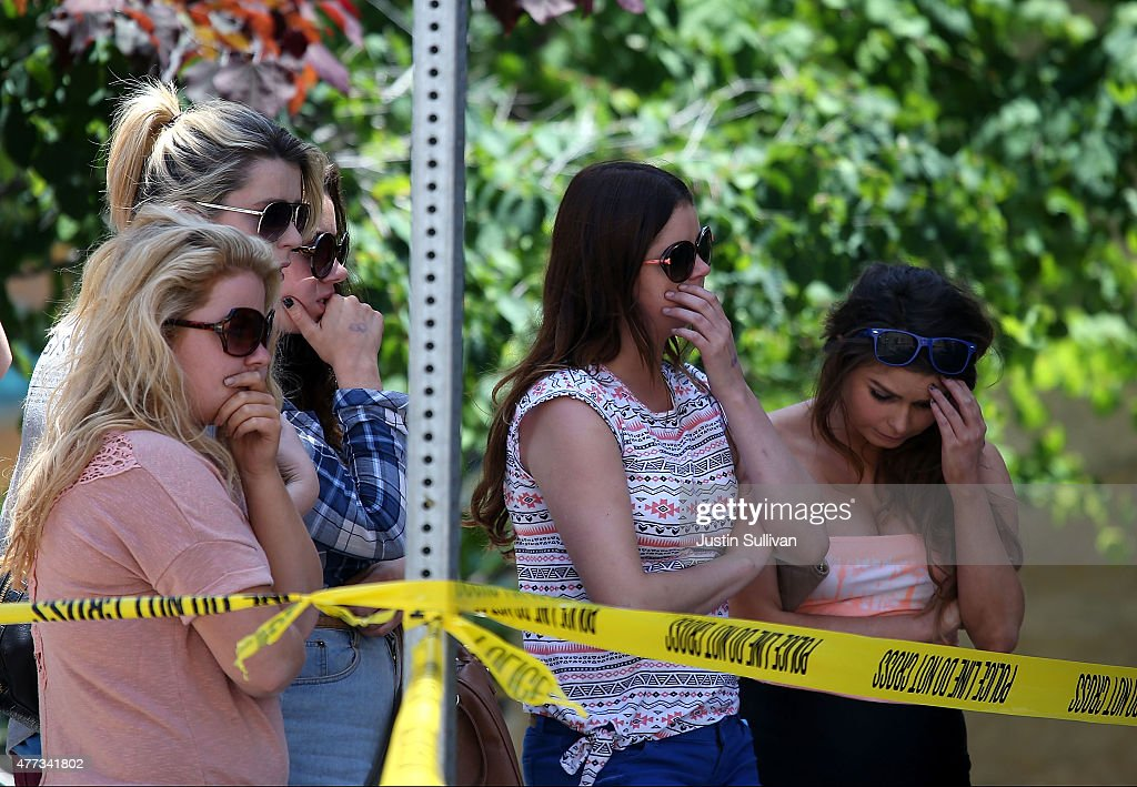 People look on at the scene of a balcony collapse at an apartment building near UC Berkeley on June 16 2015 in Berkeley California 6 people were...