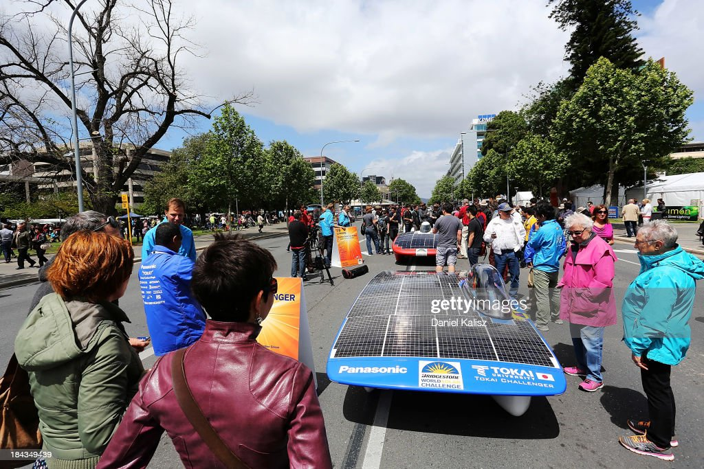 People look on at the Tokai Challenger of Tokai University, Challenger Class from Japan during the 2013 World Solar Challenge street parade on October 13, 2013 in Adelaide, Australia. Over 25 teams from across the globe competed in the 2013 World Solar Challenge, a 3000 km solar-powered vehicle race between Darwin and Adelaide, which was won by Dutch team Nuon from the Delft University of Technology.