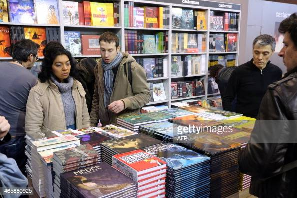 People look on comic strips on French publisher Casterman's booth on the first day of the 'Festival international de la bande dessinee' in Angouleme...