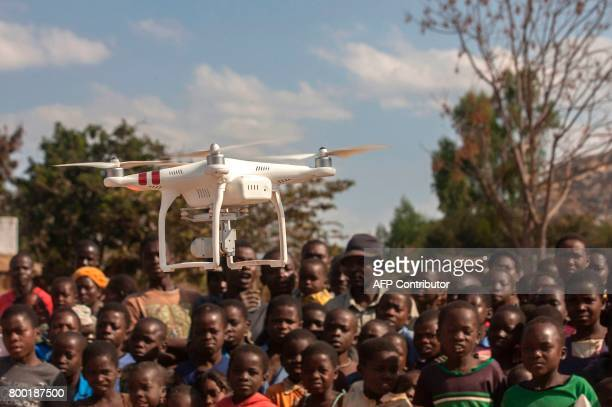 TOPSHOT People look on during a drone awareness and safety demonstration on June 22 in regards to humanitarian drone corridor testing under the...