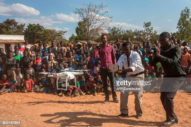 People look on during a drone safety and awareness demonstration on June 22 in regards to humanitarian drone corridor testing under the UNICEFfunded...