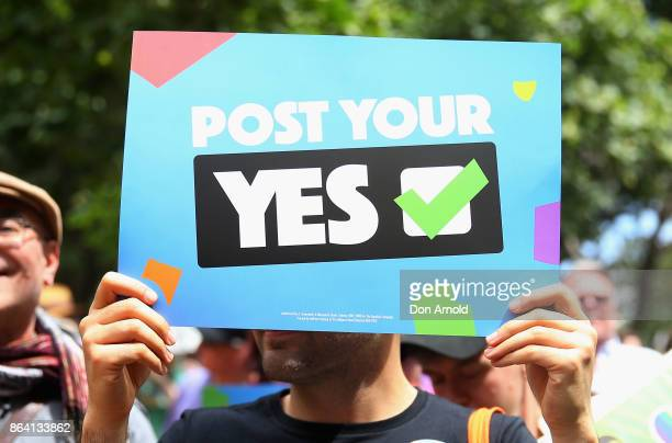 People look on during a speech at the YES March for Marriage Equality on October 21 2017 in Sydney Australia Australians are currently taking part in...