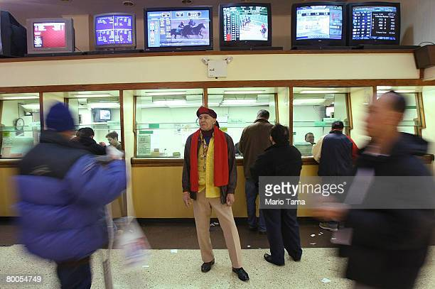 People look on inside an OffTrack Betting parlor in Midtown Manhattan February 28 2008 in New York City The board that oversees New York City's OTB...