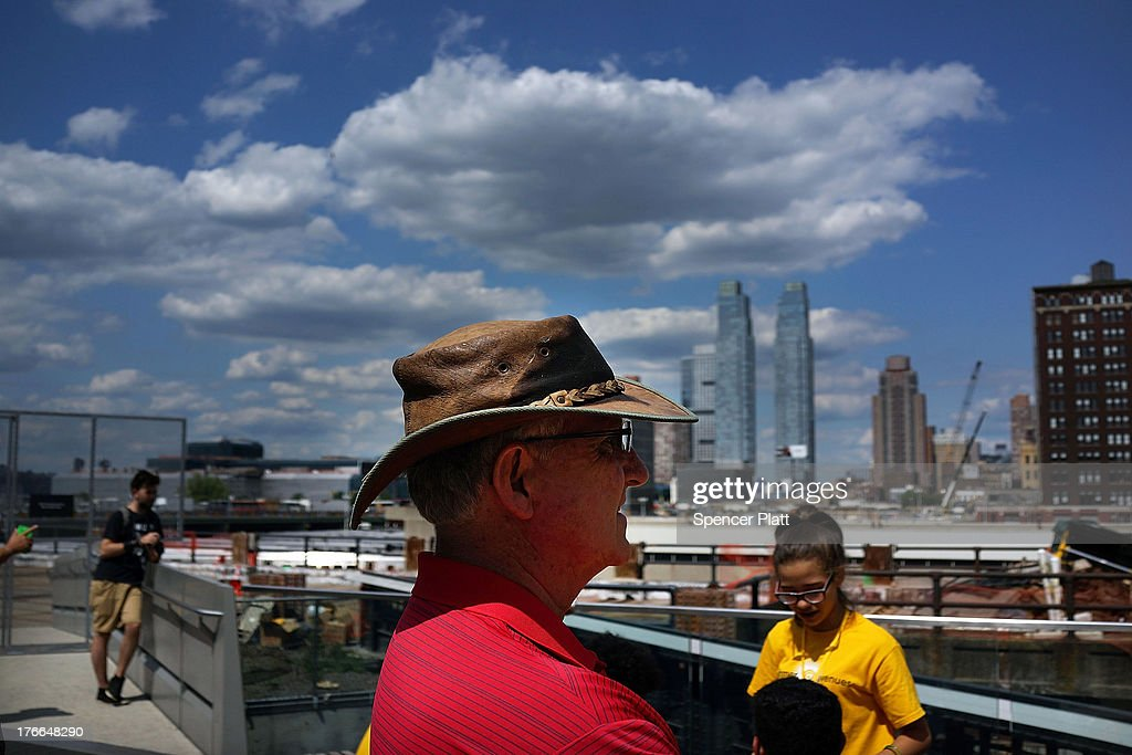 People look out at construction at the Hudson Yards Redevelopment Project which is developing Manhattan's far West Side along the Hudson River in New York City on August 16, 2013 in New York City. The plan envisions thousands of new residential, hotel, park and office space in an area of the Manhattan that has historically been neglected by real estate developers. A new report by the office of Brooklyn Democrat and housing expert Brad Lander, a City Councilman, found that less than 2 percent of all apartments developed in the city since 2005 were deemed affordable housing. New York City Mayor Michael Bloomberg launched 'Inclusionary Housing Program' eight years ago in an attempt to get developers to to build larger and taller as long as they also set aside a portion of their apartments for low- to middle-income tenants.