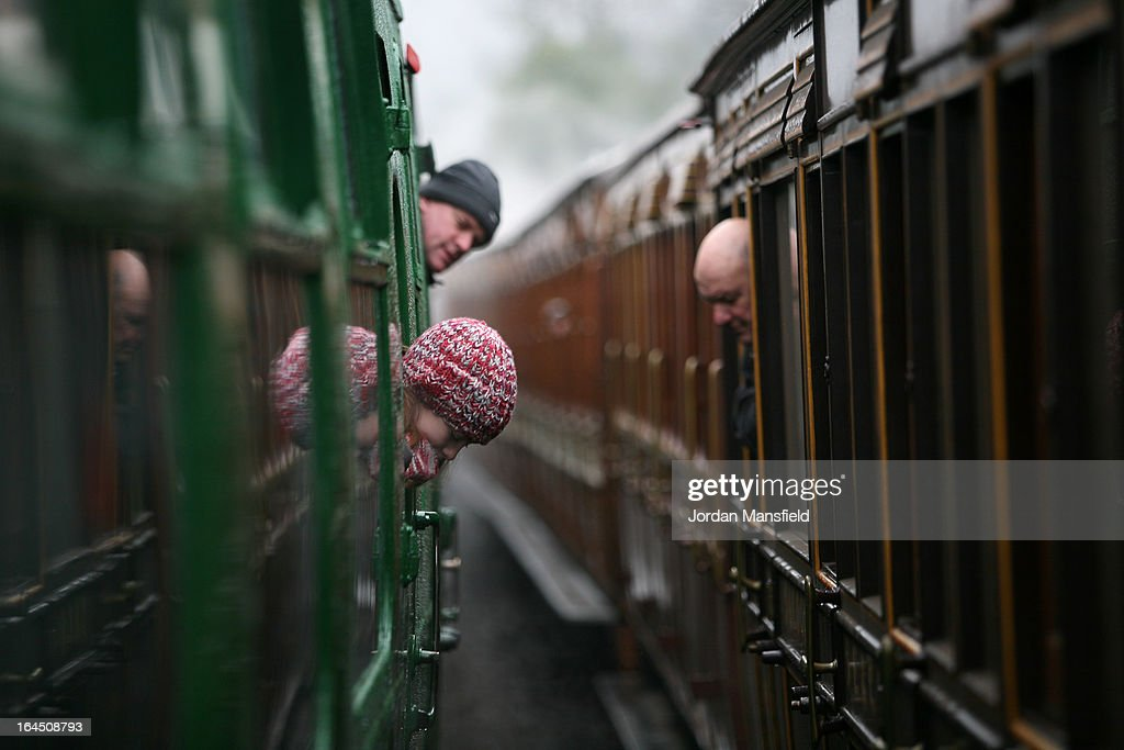 People look out of the windows of two trains as they pass at Horsted Keynes Station on March 23, 2013 in Horsted Keynes, England. The Bluebell Railway ran its first steam train this weekend on the reclaimed line from Kingscote to East Grinstead after volunteers from the Bluebell Society worked to reopen the line after its closure on March 17, 1958. 50 years on from Dr. Richard Beeching's report signaling the widespread closure of rural rail routes across the UK, Britain's railways are in great demand with old lines reopening and pressure on to restore rural lines that were closed.