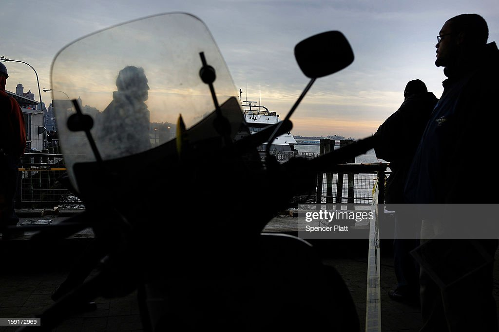 People look out over the Seastreak ferry following an early morning ferry accident during rush hour in Lower Manhattan on January 9, 2013 in New York City. At least 50 people were injured in the accident, which left a large gash on the front side of the Seastreak ferry at Pier 11.