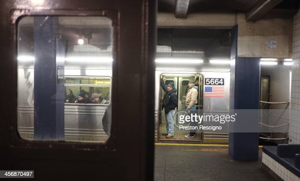 People look over at the Metropolitan Transit Authority 'Nostalgia' vintage subway train from a F train on the opposite track on December 15 2013 in...