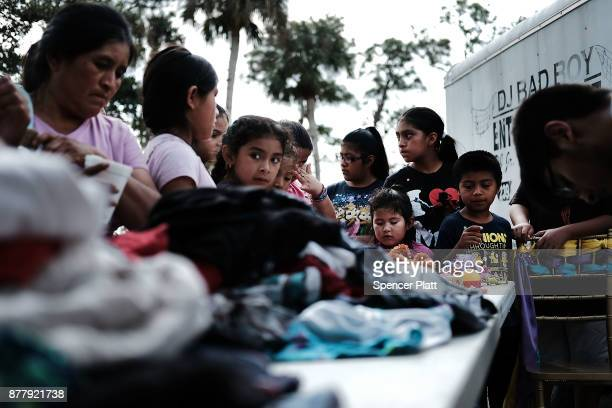 People look through donated clothes at the annual Thanksgiving in the Park gathering where residents of the farm worker community of Immokalee are...