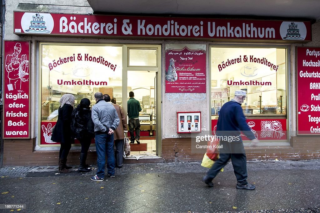 People look through the window of a Lebanese confectionery at Sonnenallee in Neukoelln district on November 02, 2013 in Berlin, Germany. According to recently published statistics, 7.2 million foreigners were living in Germany by the end of 2012, which is the highest number ever recorded. Of those 80% are from countries in the European Union, while the rest come primarily from Turkey, Russia, the former Soviet states and Arab countries.