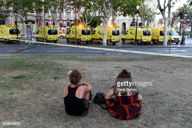 People look toward the scene of a terrorist attack in the Las Ramblas area on August 17 2017 in Barcelona Spain Officials say 13 people are confirmed...
