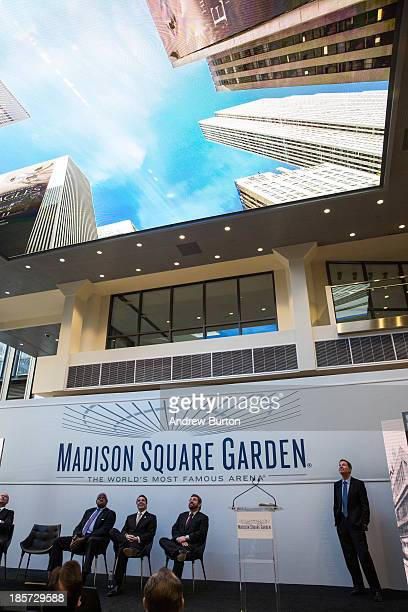 People look up and watch a video on a new 600 square foot video display attached to the ceiling of one of Madison Square Garden's entrances during a...