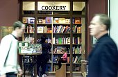 People looking at books in the Cookery Book Section in Collins Booksellers Broadway Shopping on 3rd August 2001 THE AGE BUSINESS Picture by EDWINA...