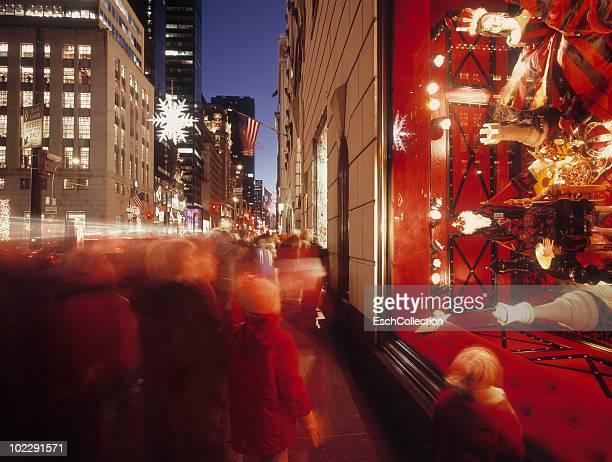 People looking at Christmas display in New York.