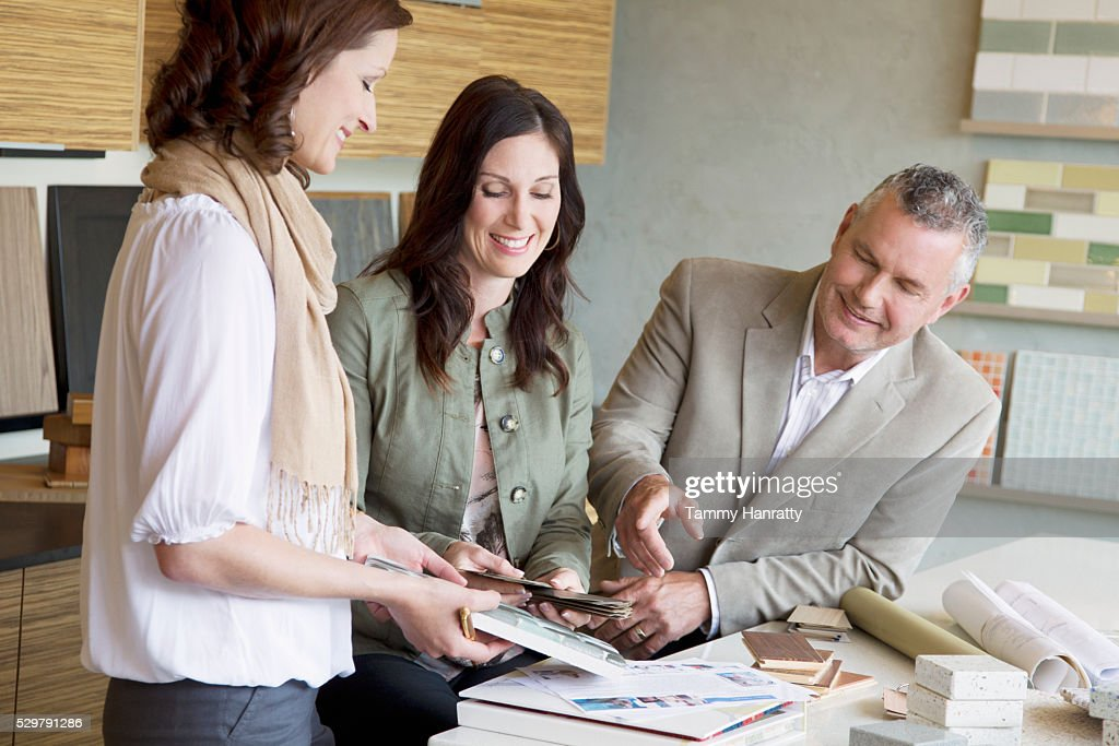 People looking at color swatches : Stock Photo