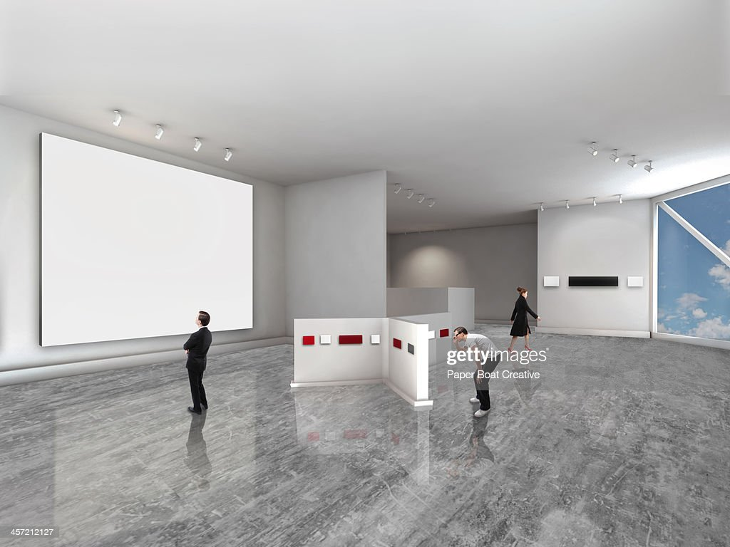 People looking at different artwork in gallery : Stock Photo