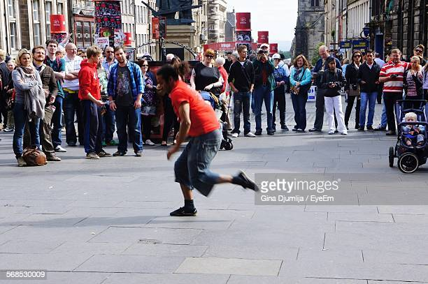 People Looking At Man Dancing On Street