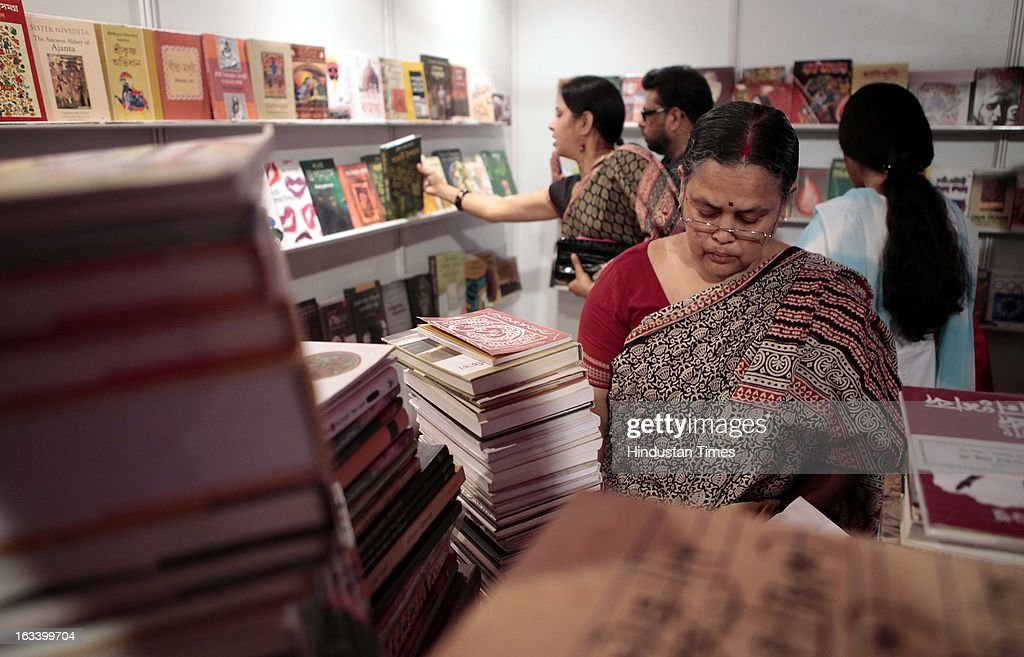 People looking at various books at the 12th Boi Mela book fair at Kali Bari, Mandir Marg on March 9, 2013 in New Delhi, India.