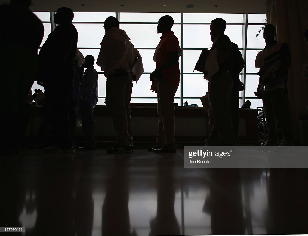 People looking for work stand in line to apply for a job during a job fair at the Miami Dolphins Sun Life stadium on May 2, 2013 in Miami, Florida. If voters approve a hotel tax hike to fund stadium renovations the jobs would be available. If not, the Dolphins management is indicating they would not be able to renovate the stadium nor create the jobs.