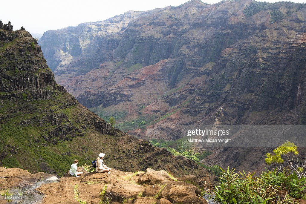 People looking out over cliffs : Stock Photo