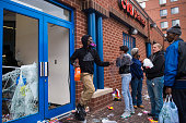 People loot a CVS pharmacy near West North Avenue and Pennsylvania Avenue during a protest for Freddie Gray in Baltimore MD on Monday April 27 2015...