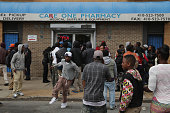 People loot a pharmacy along Pennsylvania Ave following the funeral of Freddie Gray April 27 2015 in Baltimore Maryland Gray who was arrested for...