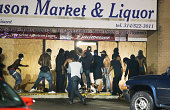 People loot the Ferguson Market and Liquor store on August 16 2014 in Ferguson Missouri Several businesses were looted as police held their position...
