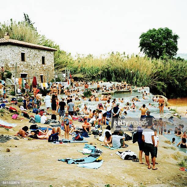 People lounging around Saturnia Thermal pool