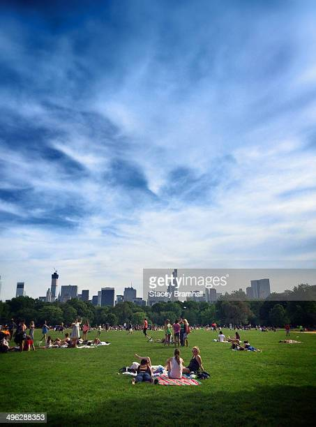 People lounging on the grass in New York City's Central Park on Memorial Day