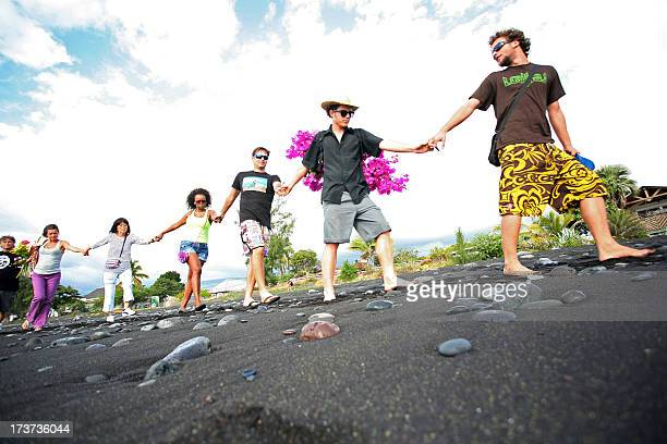 People make a chain as they pay homage in SaintPaul on July 17 2013 to Sarah a teenage girl tourist killed in a shark attack on July 15 while...