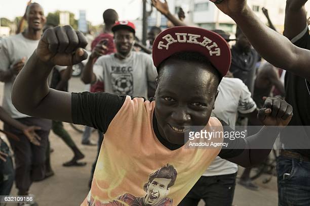People make celebrations on the streets after Gambian presidentelect Adama Barrow's swearingin ceremony at Gambian Embassy in Senegal's Dakar in...