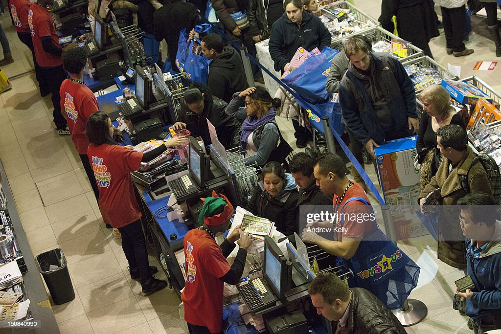 People make purchases at the Black Thursday sale at the Toys 'R' Us store in Times Square November 22, 2012 in New York City.The store got a head start on the traditional Black Friday sales by opening their doors at 8pm on Thanksgiving night.