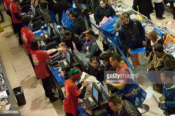 People make purchases at the Black Thursday sale at the Toys 'R' Us store in Times Square November 22 2012 in New York CityThe store got a head start...