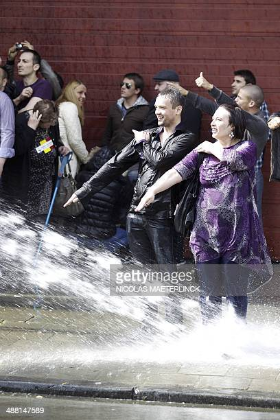 People make the controversial 'quenelle' gestures as the police uses water cannon to disperse protestors who attempt to participate in an antiSemitic...