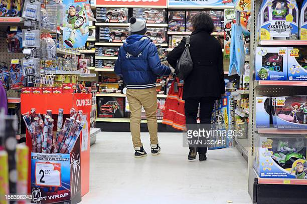 People make their Christmas shopping in a toys shop on December 15 2012 in SaintPierredesCorps near Tours AFP PHOTO/ALAIN JOCARD