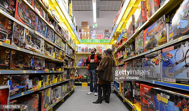 People make their shopping for Christmas in a toy shop on December 12 2012 in ChambrayLèsTours near Tour AFP PHOTO/ALAIN JOCARD