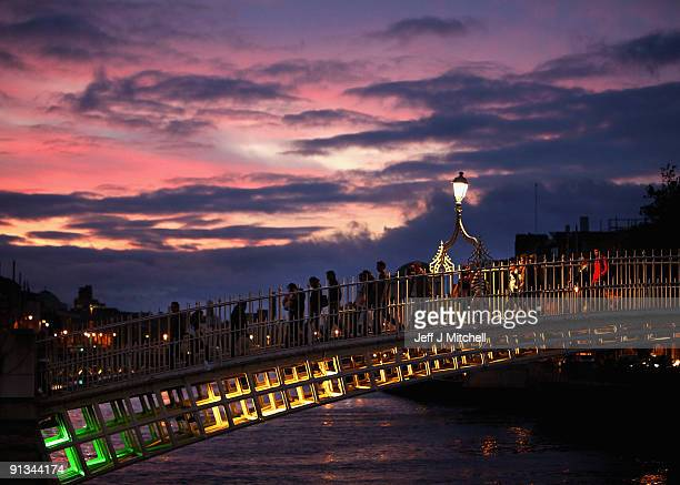 People make their way across a bridge over the river Liffey in central Dublin on October 2 2009 in Dublin Ireland The people of Ireland will vote for...
