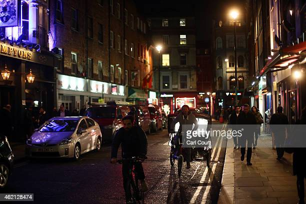 People make their way along Old Compton Street in Soho on January 16 2015 in London England A growing number of campaigners including Stephen Fry are...