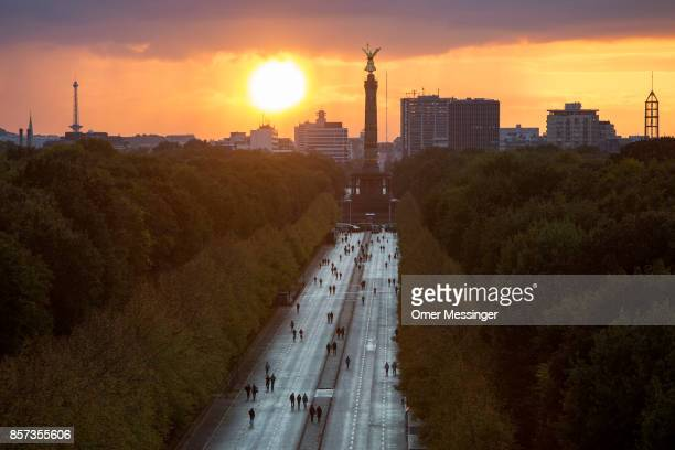 People make their way along the 17th of June Street in Tiergarten Park near the Siegessaule Victory Column on German Unity Day on October 3 2017 in...