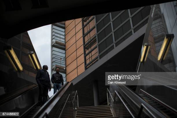People make their way down to the subway outside the European Union Commission headquarters on April 28 2017 in Brussels Belgium The 27 members of...