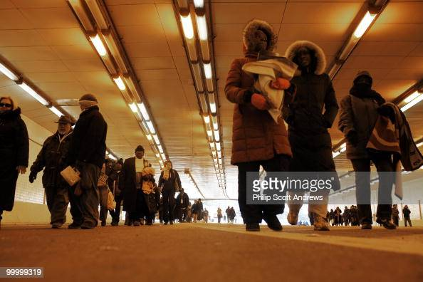 People make their way home through the I95 tunnel after spending the day in subzero temperatures on the National Mall after the 56th Inauguration on...