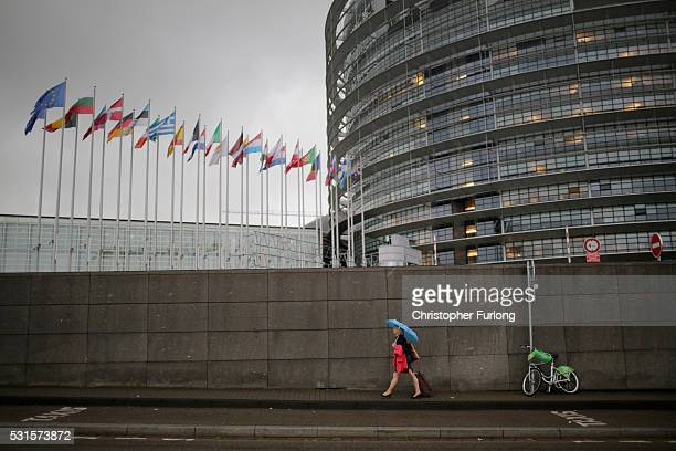 People make their way into the European Parliament during a rain storm on May 12 2016 in Strasbourg France The United Kingdom will hold a referendum...