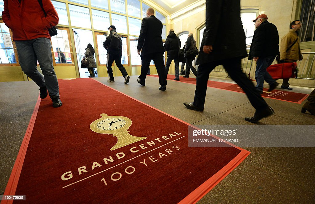People make their way on a red carpet set up as part of the centennial celebrations for Grand Central Terminal in New York, February 1 , 2013 . Grand Central Terminal, the doyenne of US train stations, is celebrating its 100th birthday on February 2, 2013. Opened on February 2, 1913, when trains were a luxurious means of traveling across America, the New York landmark with its Beaux-Arts facade is still one of the US largest transportation hubs and is also New York's second-most-popular tourist attraction, after Times Square. AFP PHOTO/Emmanuel Dunand