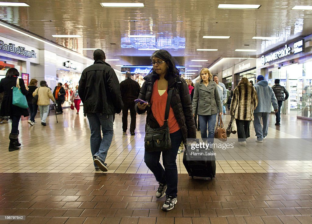 People make their way through the New York Port Authority bus terminal in Manhattan on November 21, 2012 in New York City. The Port Authority of New York and New Jersey is expecting to handle a high number of travelers at its hubs, bridges, and tunnels ahead of the Thanksgiving holiday.