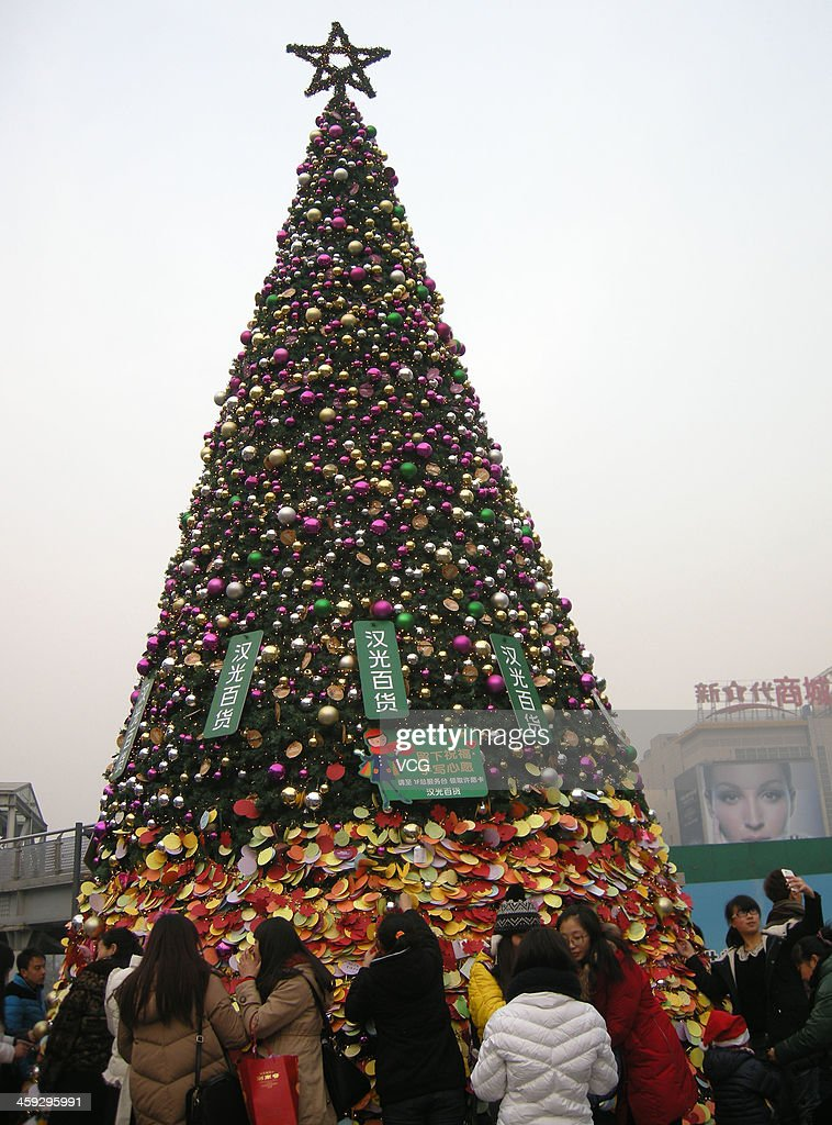 People make wishes to a giant Christmas Tree to celebrate the Christmas Eve on December 24, 2013 in Beijing, China.