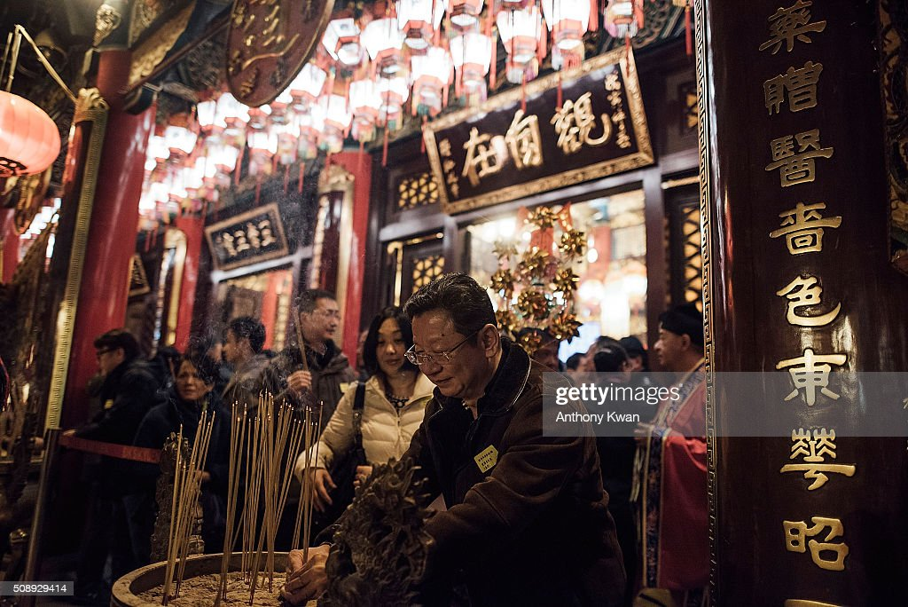 People makes incense offerings and pray at Wong Tai Sin Temple on the first day of Lunar New Year Holiday on February 8, 2016 in Hong Kong. Tens of thousands of worshippers flocked to temples across to pray for good luck and fortune for the Year of Monkey. The Chinese Lunar New Year also known as the Spring Festival, which is based on the Lunisolar Chinese calendar, is celebrated from the first day of the first month of the lunar year and ends with Lantern Festival on the fifteenth day.